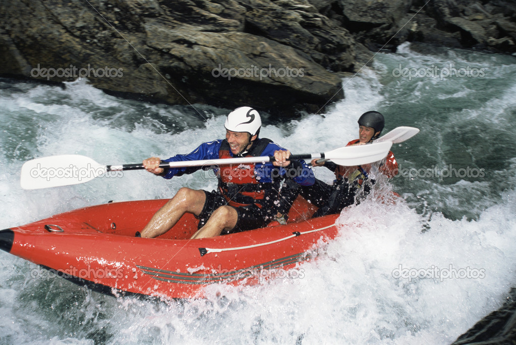 Two paddling inflatable boat down rapids — Stock Photo #4754699