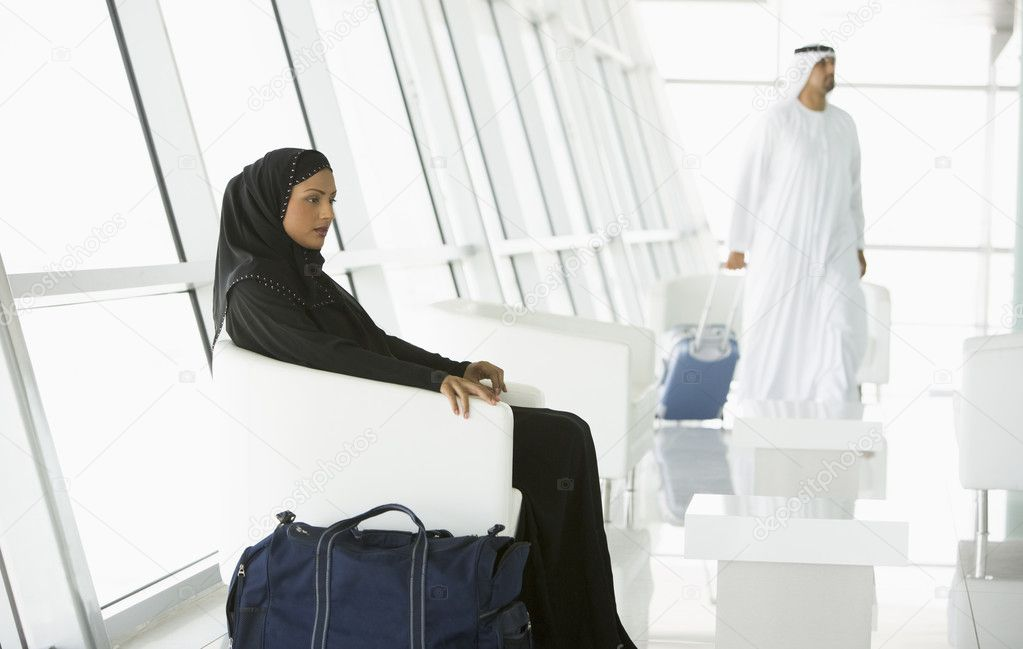 Passengers waiting in airport departure lounge  Stock Photo #4754847