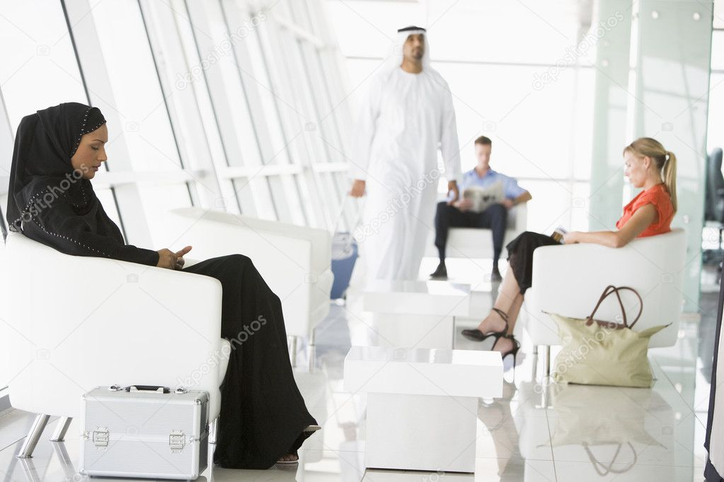 Passengers waiting in airport departure lounge — Stock Photo #4754853