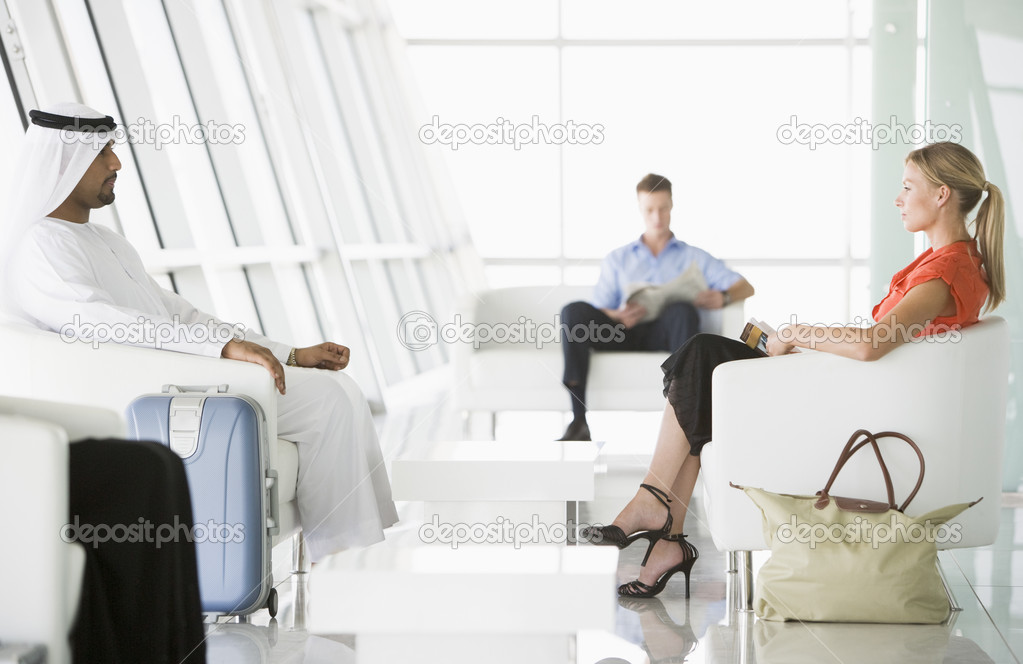 Passengers waiting in airport departure lounge — Stock Photo #4754855