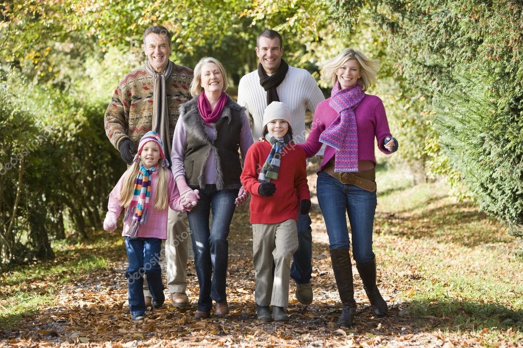 Multi-generation family on walk through autumn woods — Stock Photo #4754879