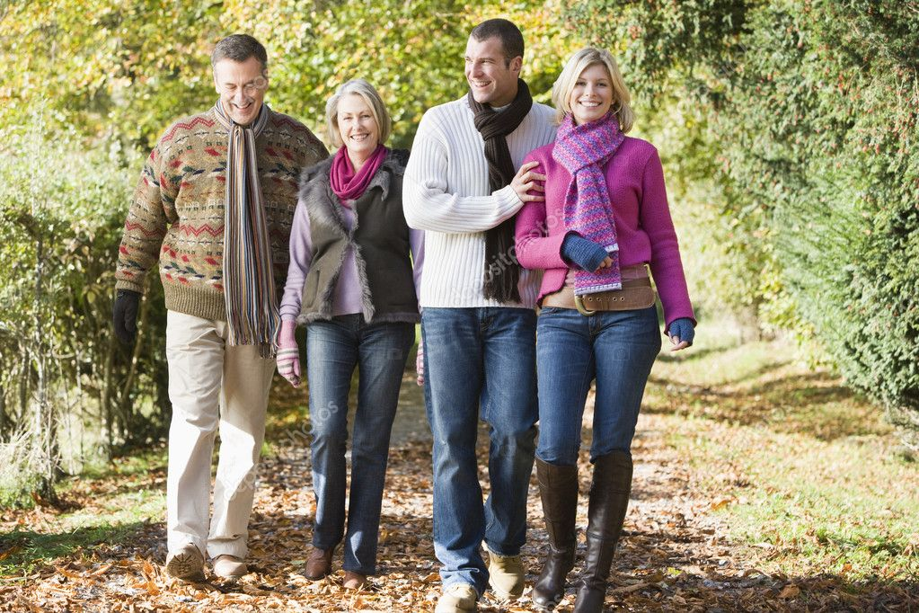Multi-generation family enjoying walk through autumn woods  Photo #4754880