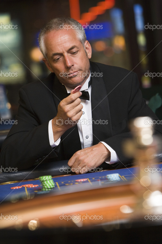 Man losing at roulette table in casino  Stock Photo #4755242