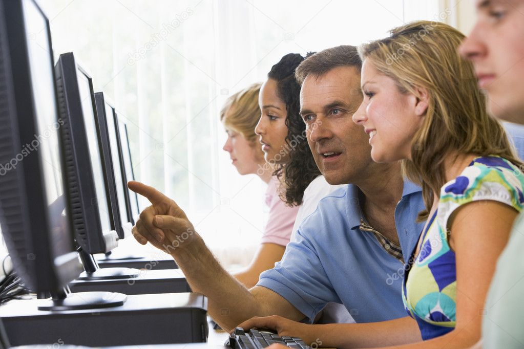 Teacher assisting college student in a computer lab — Stock Photo #4755383