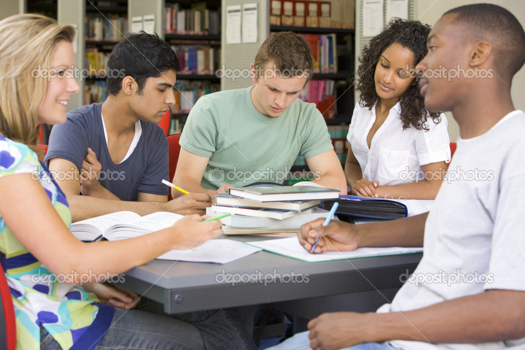 College students studying together in a library — Foto Stock #4755435