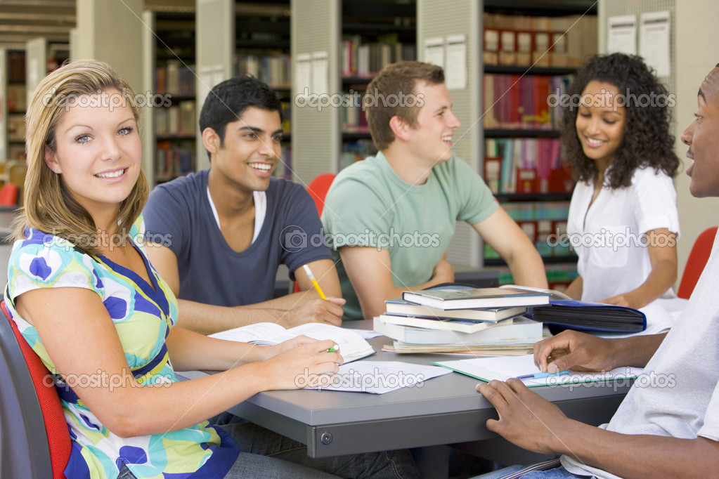 College students studying together in a library — Stock Photo #4755442