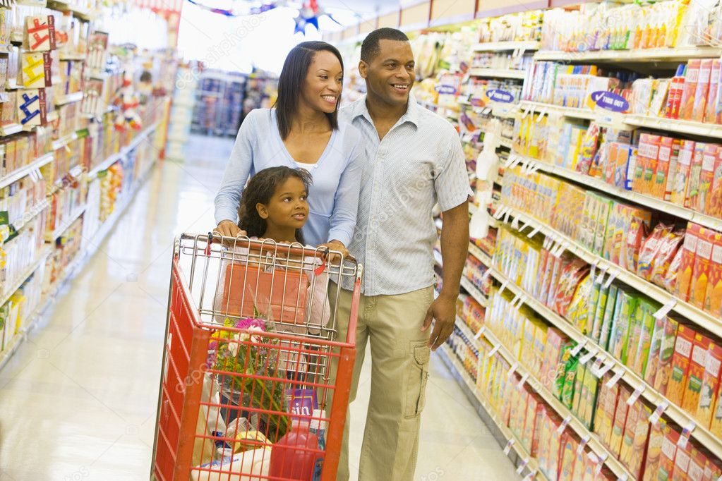 Family shopping for groceries in supermarket  Stock Photo #4757703