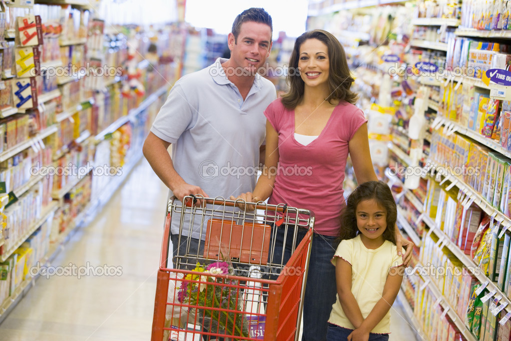 Family shopping for groceries in supermarket  Stock Photo #4757721