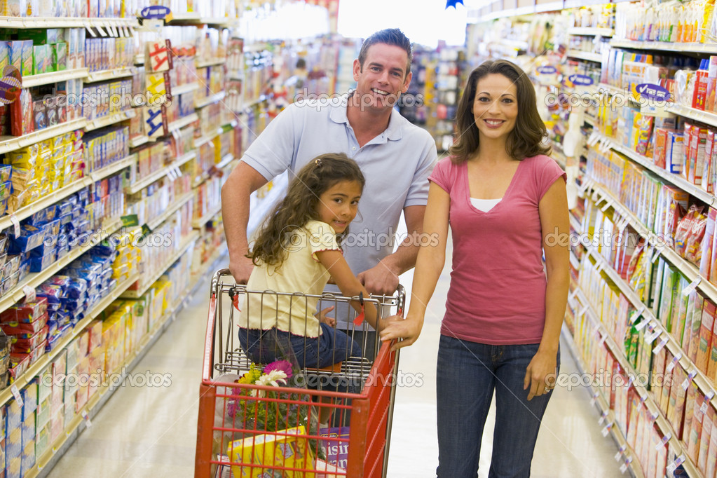 Young family grocery shopping in supermarket — Stock Photo #4757847