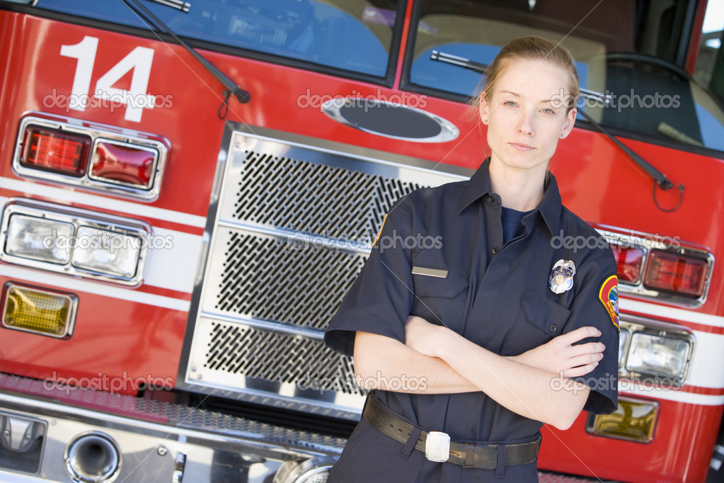 Portrait of a firefighter by a fire engine — Stock Photo #4758103