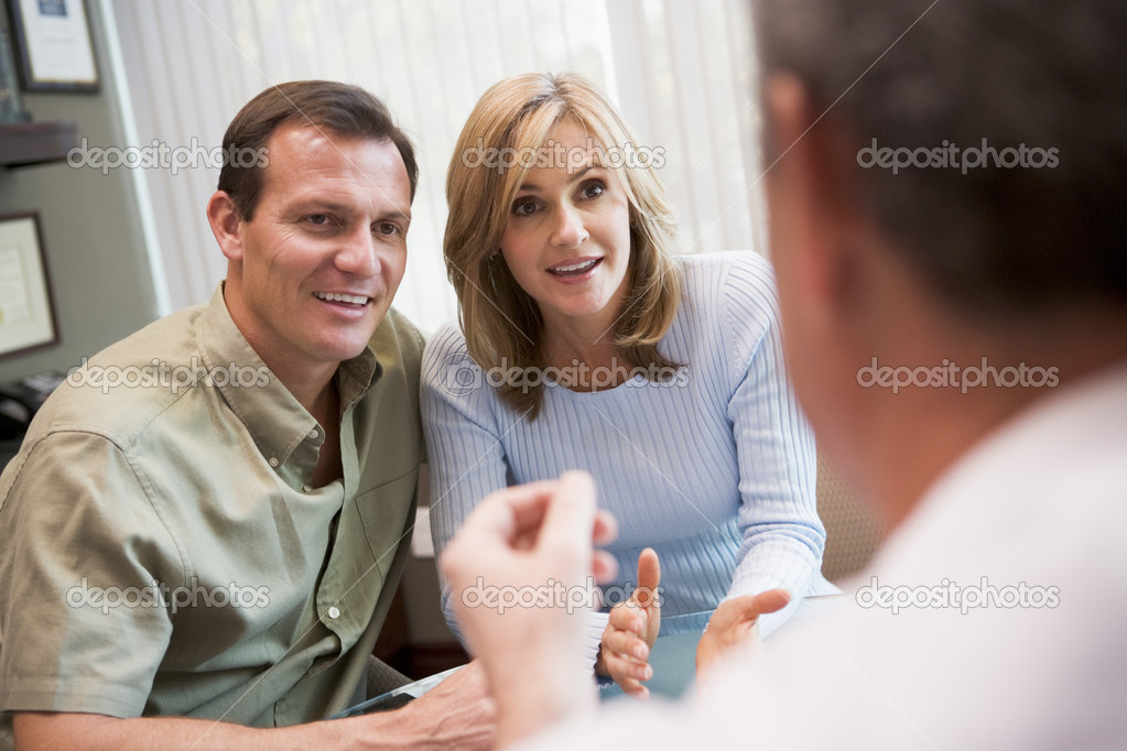 Couple in consultation at IVF clinic talking to physician  Stock Photo #4759299