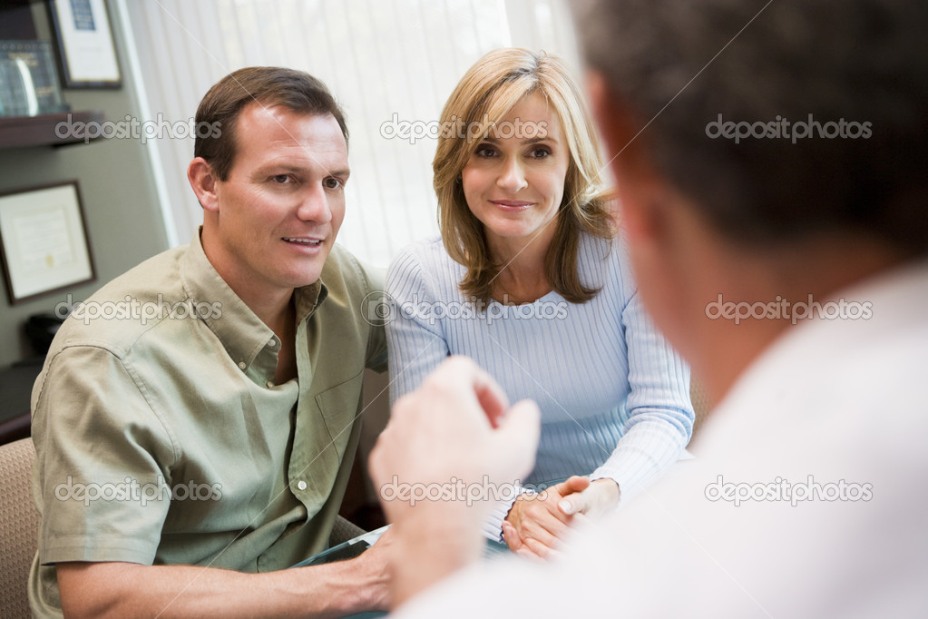 Couple in consultation at IVF clinic talking to doctor — Stock Photo #4759300