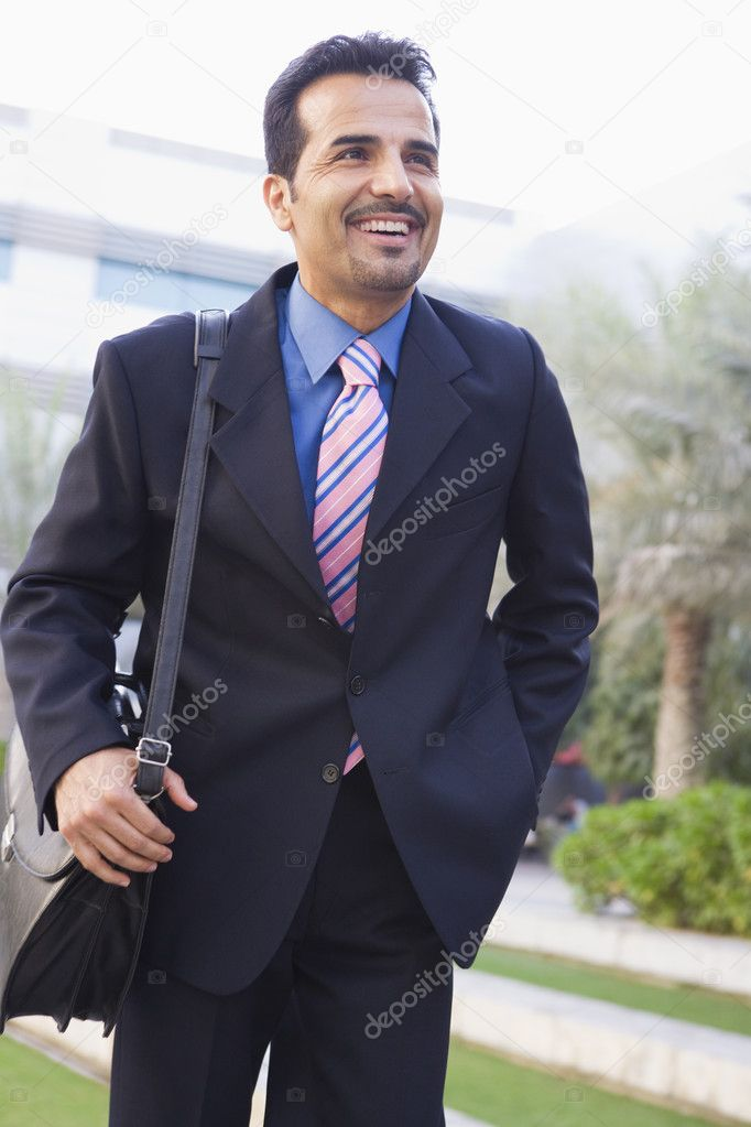 Businessman walking to office carrying briefcase  Stock Photo #4759882