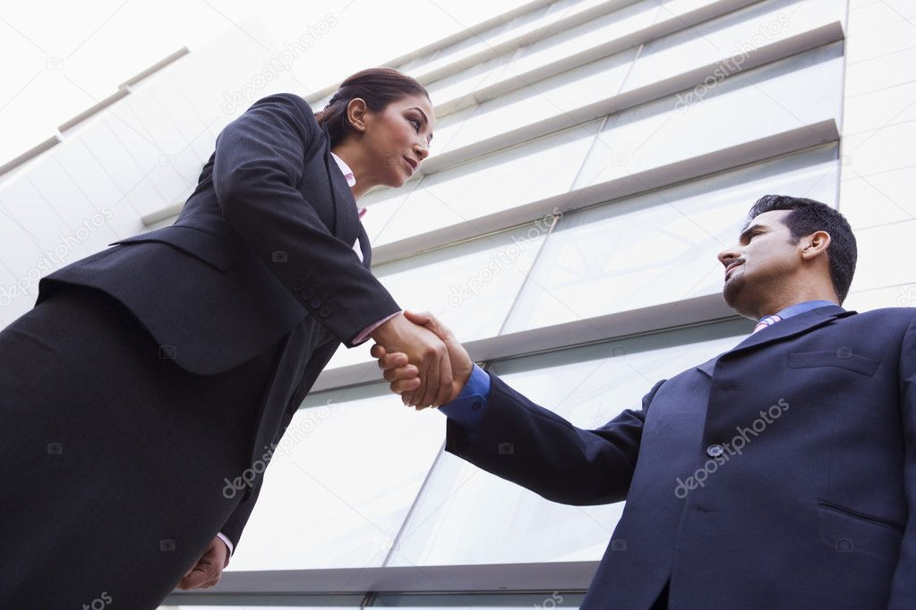 Two business shaking hands outside modern office  Stock Photo #4759906
