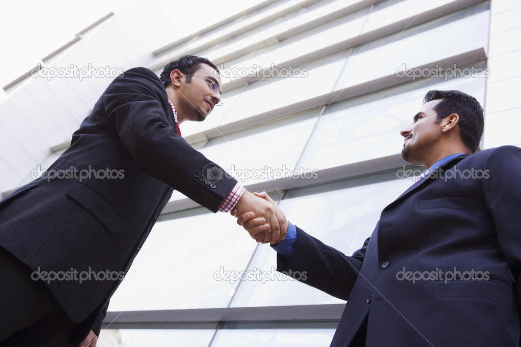 Two businessmen meeting outside modern office building — Foto de Stock   #4759912