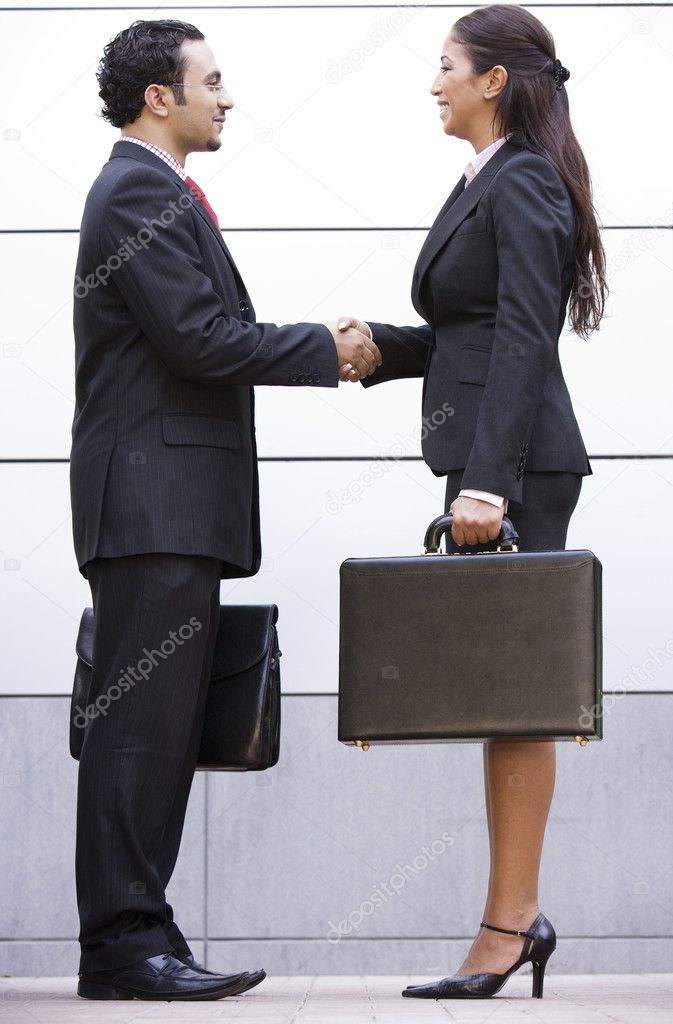 Business meeting outside modern office  Stock Photo #4759983