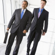 Two businessmen walking through lobby — Stock Photo