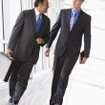 Businessmen walking through lobby — Stock Photo