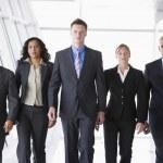 Group of business walking towards camera — Stock Photo #4760047