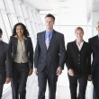 Group of business walking towards camera — Stock Photo #4760050