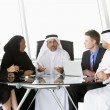 Royalty-Free Stock Photo: A  business meeting with Middle Eastern and caucasian men and wo