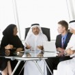 A business meeting with Middle Eastern and caucasian men and wo — Stock Photo #4760275