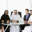 A  business meeting with Middle Eastern and caucasian men and wo — Foto Stock