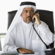 A Middle Eastern businessman talking on the phone — Stock Photo #4760312