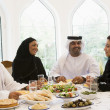 A Middle Eastern family enjoying a meal — Stock Photo