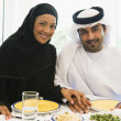 Stock Photo: Middle Eastern couple enjoying meal