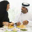 A Middle Eastern couple enjoying a meal — Stock Photo