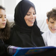A Middle Eastern family reading a book together — Stock Photo #4760384