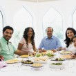 A Middle Eastern family enjoying a meal together — Stock Photo