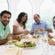 Stock Photo: Middle Eastern family enjoying meal together