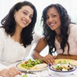 Two women enjoying a meal together — Stock Photo