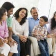 A Middle Eastern family sitting together on a couch — Stockfoto #4760472
