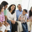 A Middle Eastern family sitting together on a couch — Stock Photo #4760472