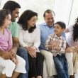 Stock Photo: A Middle Eastern family sitting together on a couch