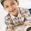 Stock Photo: Middle Eastern boy reading book