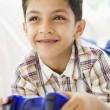 A Middle Eastern boy playing a video game — Stock Photo