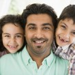 Stock Photo: Middle Eastern mwith his children