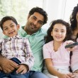 Stock Photo: Middle Eastern family watching television