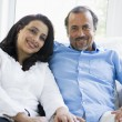A Middle Eastern couple sitting at home - Stockfoto