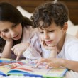 A Middle Eastern brother and sister reading together — Stock Photo