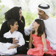 A Middle Eastern family sitting in a park — Stock Photo