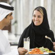 A Middle Eastern couple enjoying a meal in a restaurant — Stock Photo
