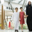 A Middle Eastern woman with two children in a shopping mall — Stock Photo #4760673
