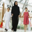 Stock Photo: Middle Eastern womwith two children in shopping mall