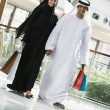 A Middle Eastern couple in a shopping mall — ストック写真