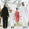 A Middle Eastern family in a shopping mall — Stock Photo